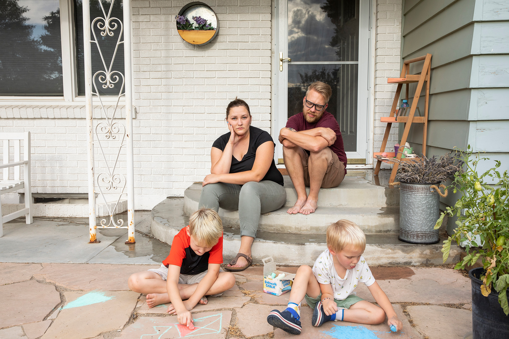Kayla Brim with her family, outside their home in Caldwell, Idaho, on Aug. 11. Brim has been sick with COVID-19 since early July.